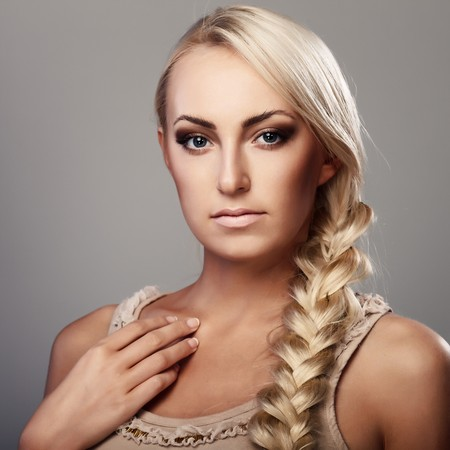 Portrait of a young lady with a braid on grey background Stock Photo - 7692865