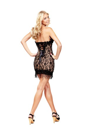 Sexy blond lady in black dress isolated on white photo