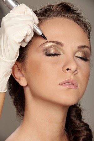 Professional permanent makeup applying photo