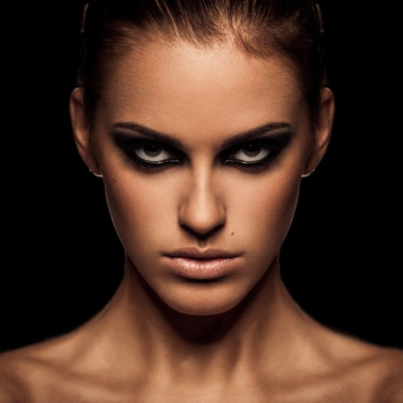 Closeup portrait of a serious lady with smoky eye makeup Stock Photo - 8245669