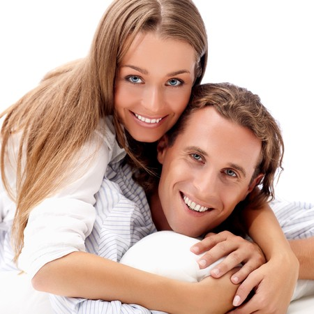 Happy smiling young couple isolated on white photo