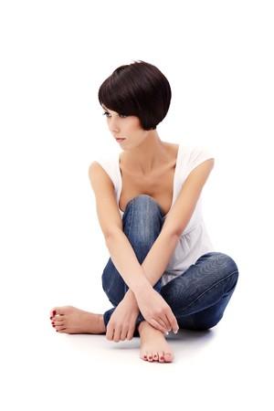 Brunette lady with blue eyes sitting on white background Stock Photo - 8326861