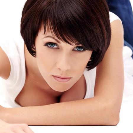 Closeup portrait of brunette female model with blue eyes on white background Stock Photo - 8314443