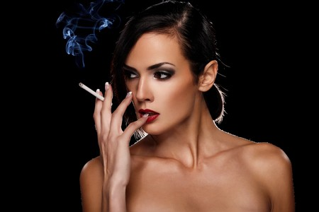 sexy lips: Elegant brunette woman smoking a cigarette on black background