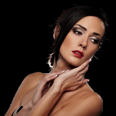 Sensual brunette lady portrait on black background photo