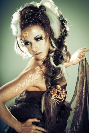 Vogue style portrait of a woman with gold-silver bodyart and makeup Stock Photo - 8388056