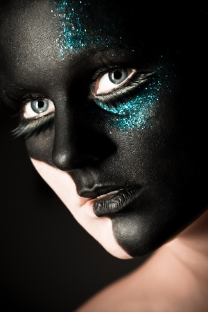 Vogue style portrait of a woman with black makeup photo