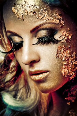 Vogue style portrait of a woman with gold makeup Stock Photo - 8900536