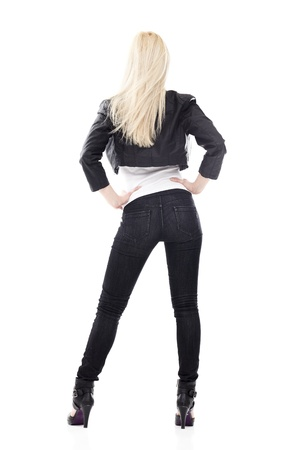 long pants: Back of young sexy blond woman in black jeans isolated on white
