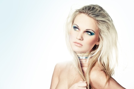 enveloped: Young blond female model with creative makeup enveloped in light