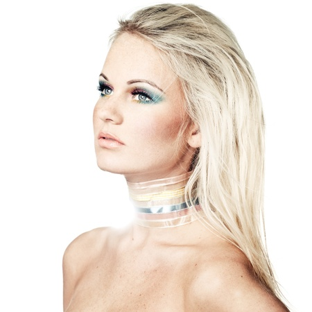 Young blond female model with creative makeup enveloped in light photo