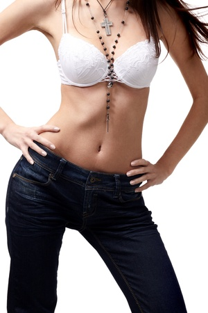 Sexy brunette woman in jeans and bra wearing silver necklace on white background Stock Photo - 9461236