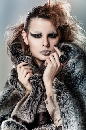 Vogue style portrait of a woman with creative hairstyle and makeup photo