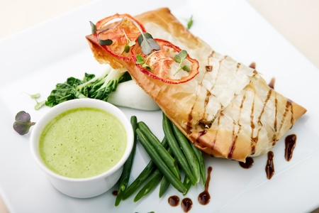 Chilean sea bass in papilliote with sauce photo