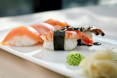 Sushi with shrimp, tuna, trout, eel and smoked salmon photo