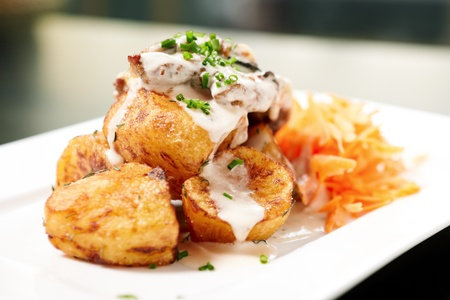 Baked pork with mushrooms and cheese, herb potatoes photo