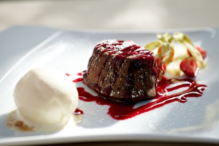 Chocolate fondant with vanilla ice cream and raspberry sauce photo
