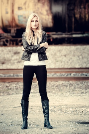 Young woman standing near a train Stock Photo - 10856960