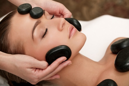 Woman lies on a table in a beauty spa getting a treatment Stock Photo - 10932735