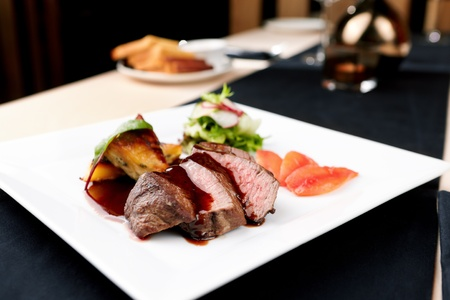 Beef fillet with potato gratin and fresh salad Banco de Imagens
