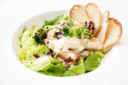 romaine: Classic Caesar salad with chicken on a plate