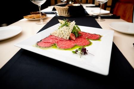 carpaccio: Beef carpaccio with salad and Parmesan cheese Stock Photo