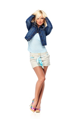 Legs and heels: Young blond woman in casual clothes isolated on white