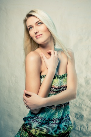 Fashion portrait of a young blond lady photo