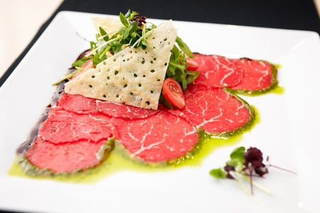 Beef carpaccio with salad and Parmesan cheese Stock Photo - 13198267