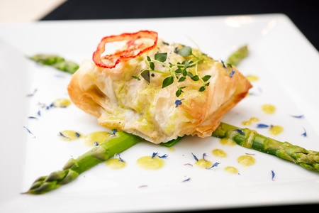 sea bass: Chilean sea-bass in papilliote on a plate
