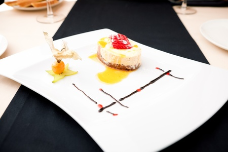 Sea buckthorn cheesecake on a plate photo