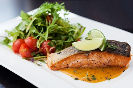 gourmet food: Smoked trout with vegetables and laim