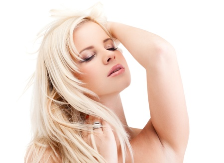 Portrait of a sensual young blond woman isolated on white background Stock Photo - 13718707