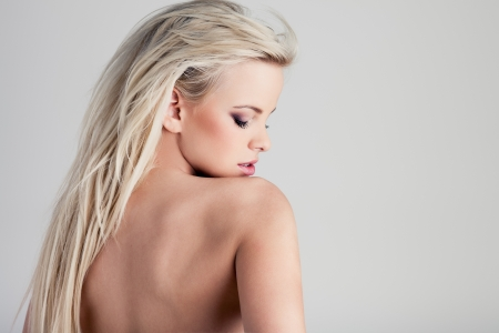 Young blond lady with a beautiful hair on gray background Stock Photo - 13718712