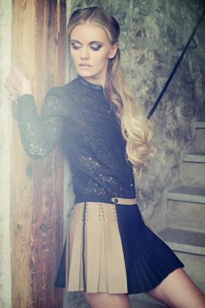 Young blond lady posing in vintage interior Banco de Imagens