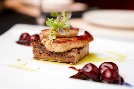duck: Fried foie gras with cherry sauce and figs Stock Photo