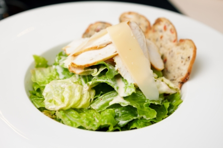 Classic Caesar salad with chicken on a plate photo