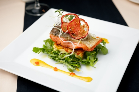 salmon steak: Baked salmon in crab sauce with vegetable casserole and ginger crisps