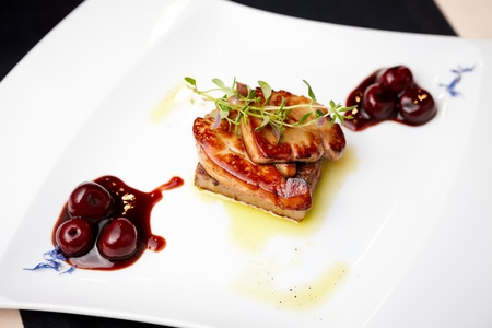Fried foie gras with cherry sauce and figs photo