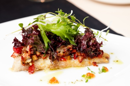 sea bass: European bass  branzino  with spicy ratatouille
