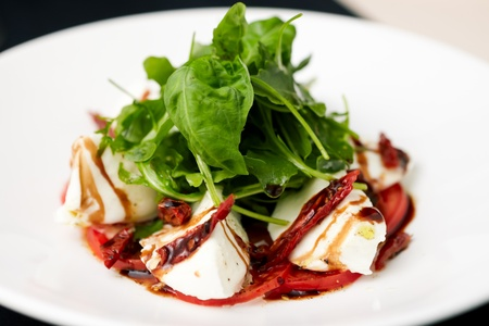 Caprese salad with ruccola and dried tomatoes Stock Photo - 14797156