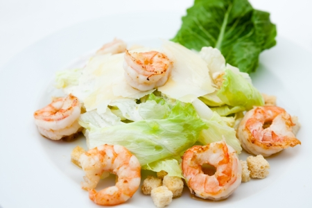 Classic Caesar salad with shrimps photo