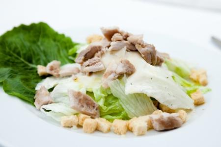 CHICKEN CAESAR SALAD: Caesar salad with chicken fillet Stock Photo
