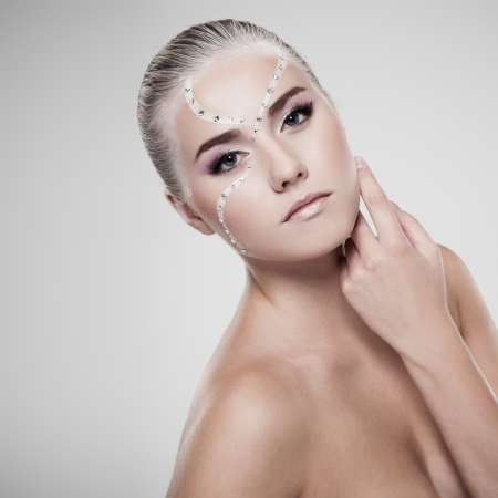 Portrait of a model with fashionable makeup on gray background Stock Photo - 15708487