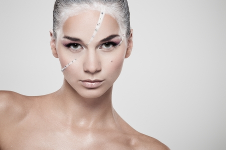 Portrait of a model with fashionable makeup on gray background photo