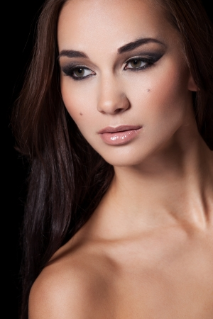 Portrait of a model with glamourous makeup on black background Stock Photo - 15895386
