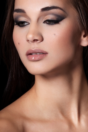 Portrait of a model with glamourous makeup on black background Stock Photo - 15895382