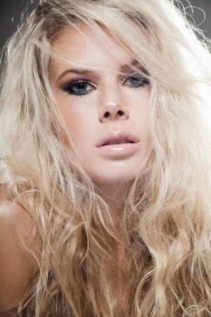 flying woman: Closeup portrait of a blond lady with hair over her face Stock Photo