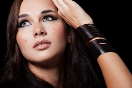 Portrait of a model with glamourous makeup on black background Stock Photo - 15895385