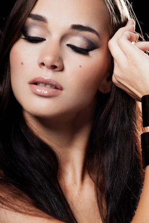 Portrait of a model with glamourous makeup on black background Stock Photo - 15895390